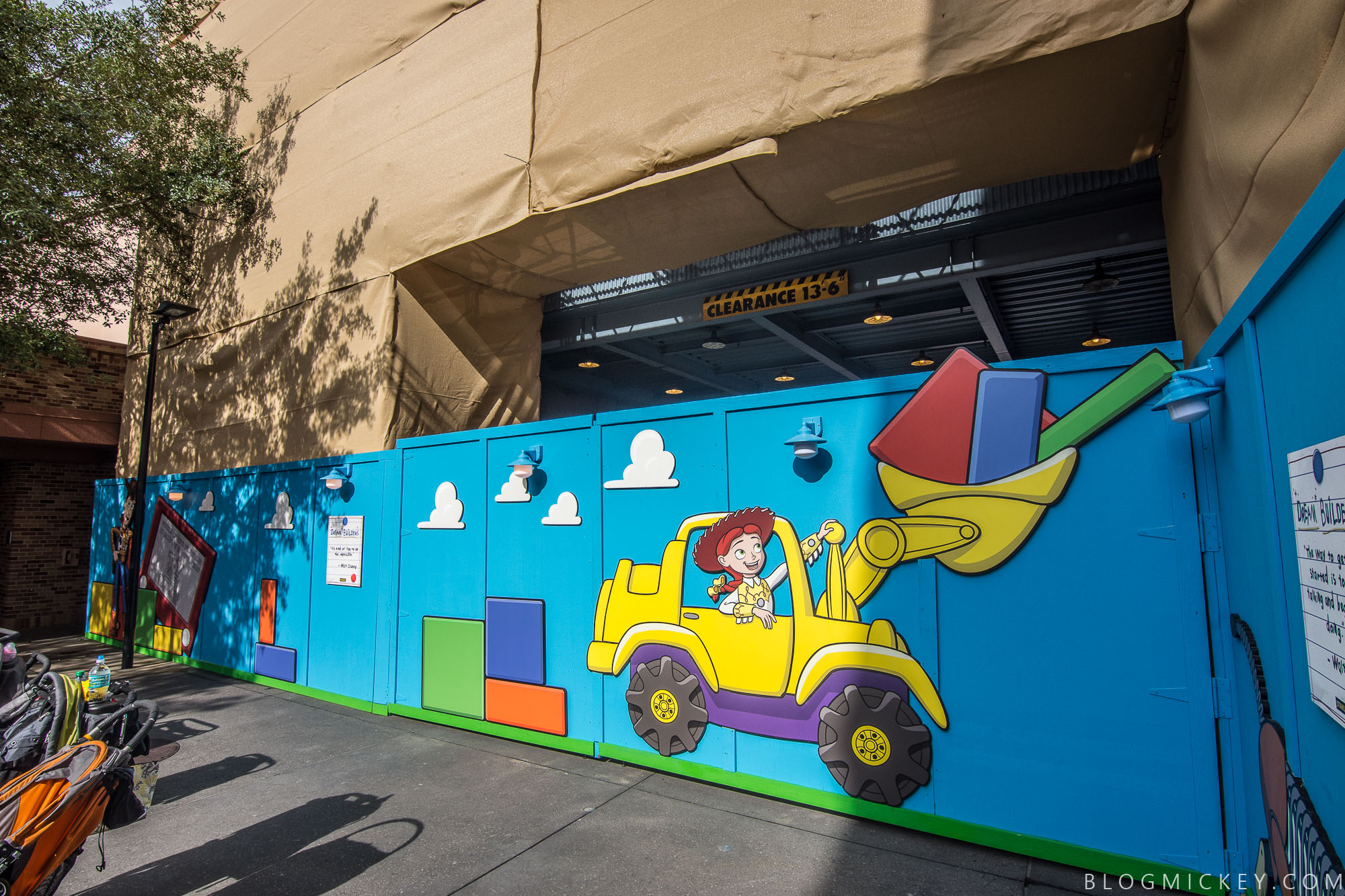 Photos toy story land logo and characters appear on construction of course the best thing about the wall is all of the toy story characters in various stages of construction themselves amipublicfo Image collections