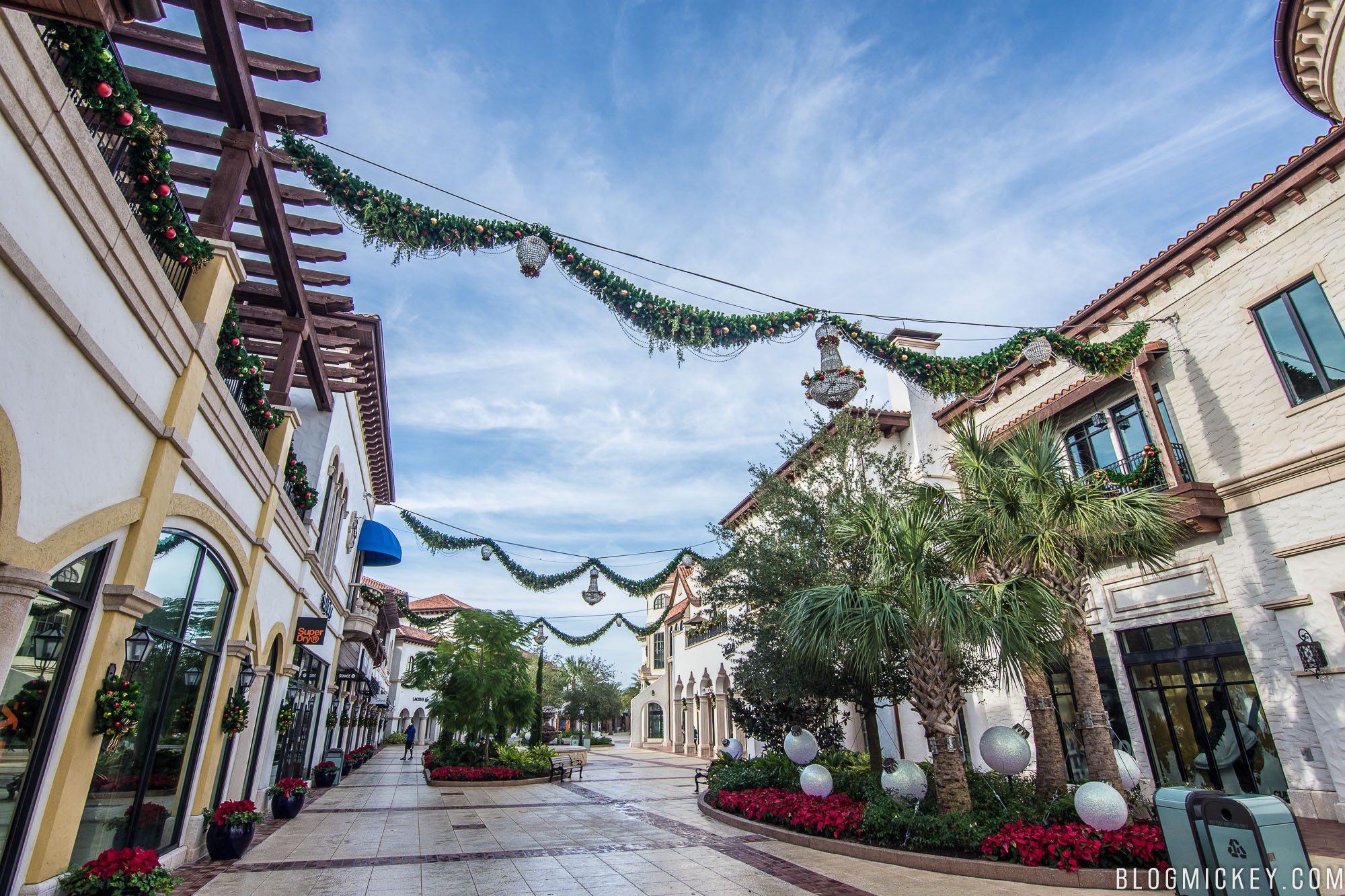 today marked the first day of holiday activities at disney springs in order to get into the holiday spirit town center has been decorated with garland