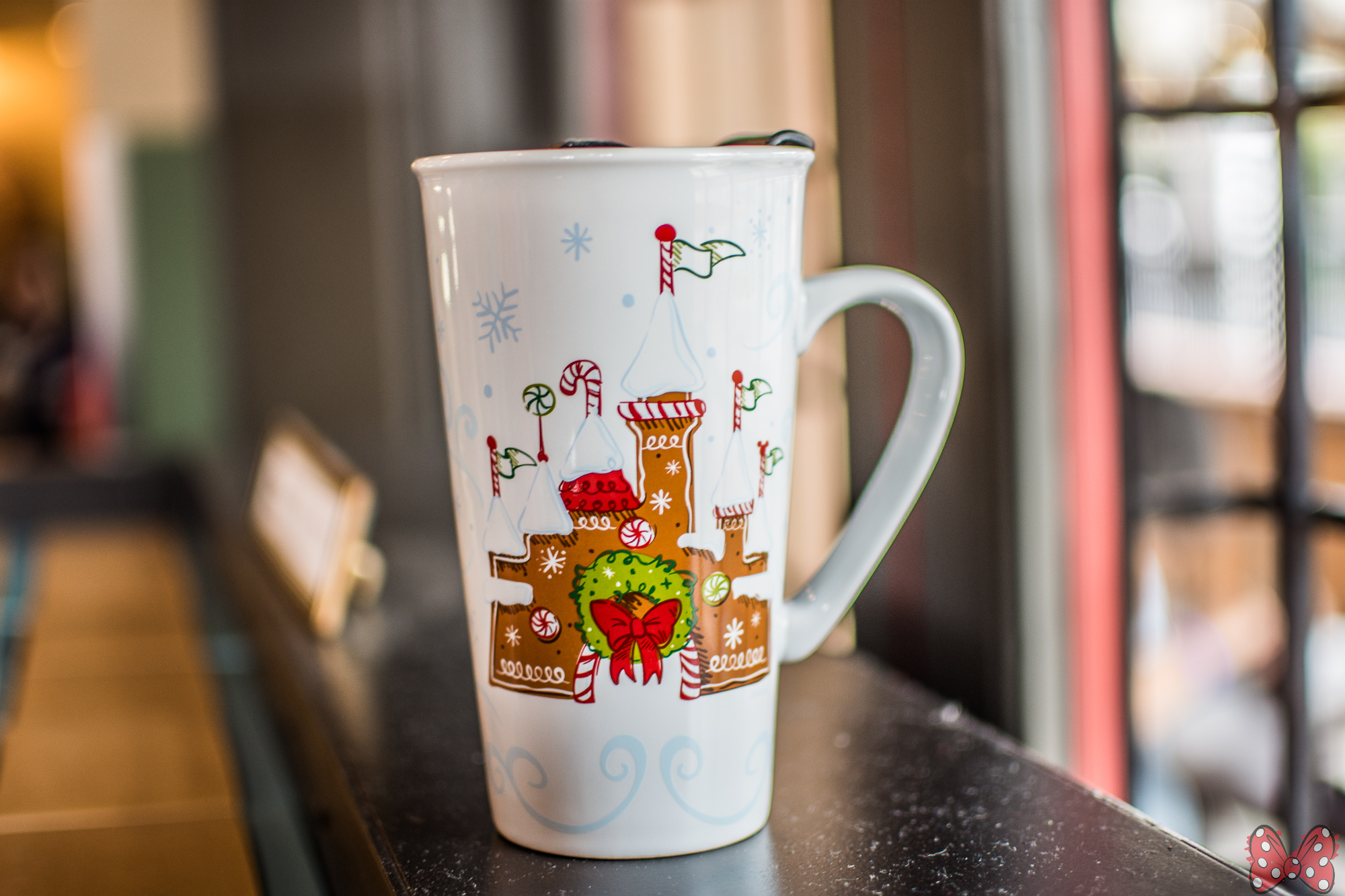 this year the mug features a gingerbread castle with a christmas wreath and peppermints the travel mug is 2199 and the ornament is 1499