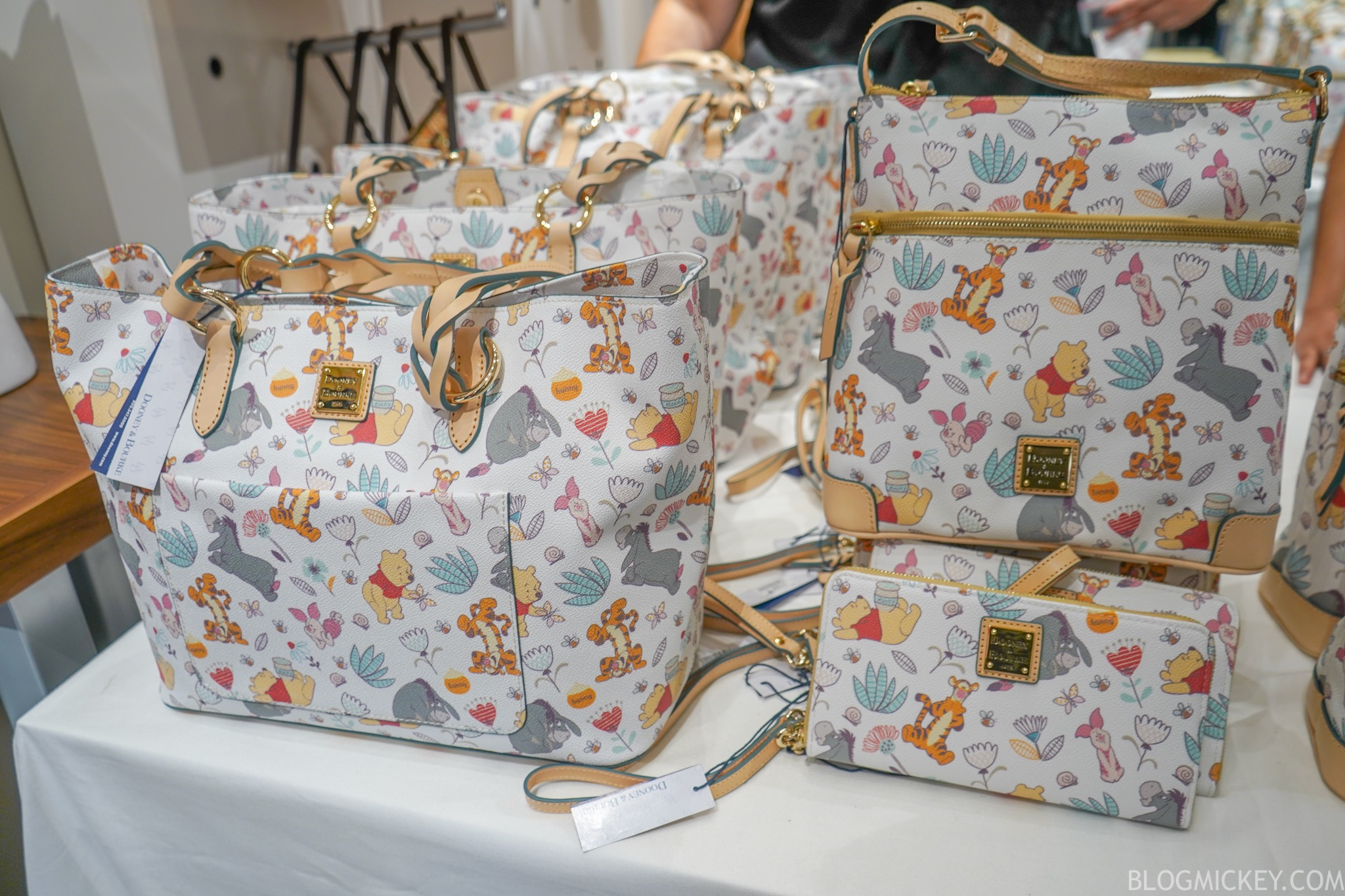 New Winnie The Pooh Dooney And Bourke Handbags Arrive At Walt Disney World